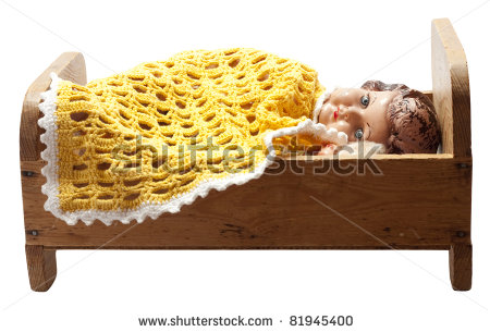 stock-photo-antique-dolls-in-an-old-vintage-wooden-doll-s-bed-81945400