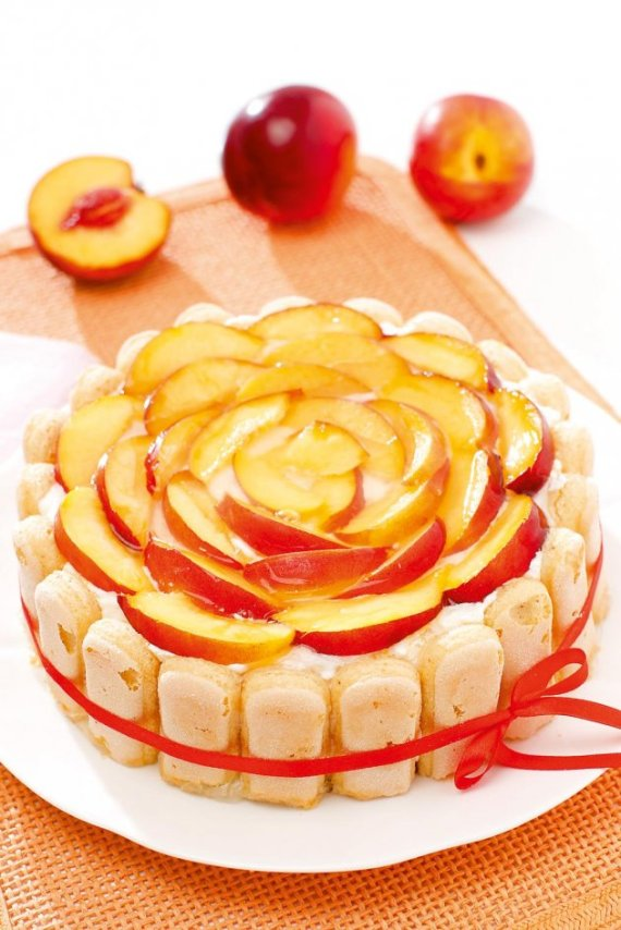 27416_cvetna-sarlota-stock-photo-delicious-peach-charlotte-biscuit-cake-84006616_iff