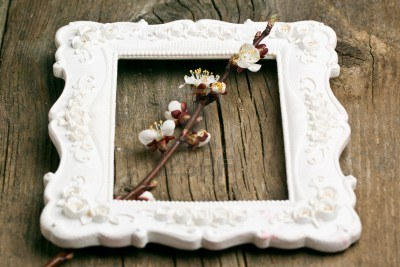 9295290-blossom-branch-of-cherry-in-beautiful-white-border-on-old-wooden-background