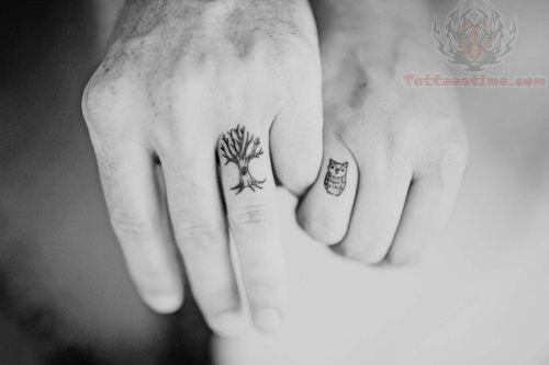 tree-and-owl-tattoo-on-fingers
