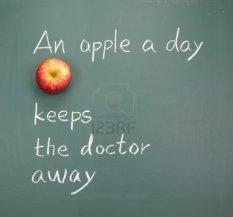 9809262-an-apple-a-day-keeps-the-doctor-away-words-on-blackboard
